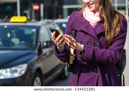 Young Woman Talking on Mobile waiting for Taxi - stock photo