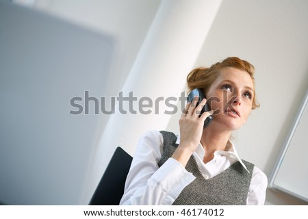 young woman talking phone in the office - stock photo
