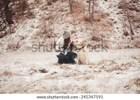 young woman talking with her dog - stock photo
