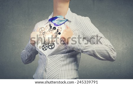 Young woman tearing shirt on chest. Mechanism concept - stock photo
