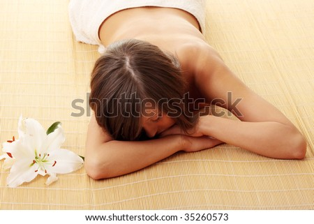 Young woman (teen girl) relaxing in massage