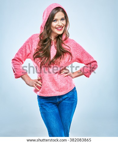 Young woman teenager style dressed posing in studio. Casual dressed. Isolated smiling girl portrait - stock photo