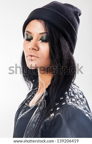 Young woman, teenager wears grunge style isolated on a white background