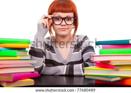 young woman, teenager with glasses and books