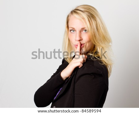 Young woman telling you to be quiet