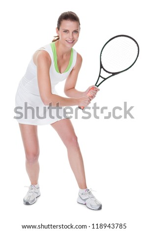 Young woman tennis player in a short white tennis dress carrying her racquet isolated on white - stock photo