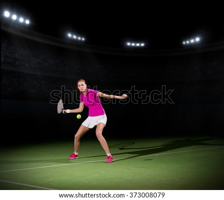 Young woman tennis player on court - stock photo