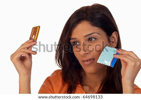 Young woman thinking about different contraceptive choices - stock photo