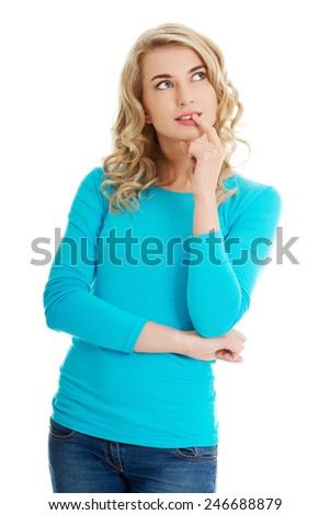 Young woman thinking about some concept - stock photo