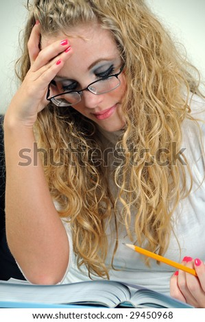 Young woman thinking holding pencil - stock photo