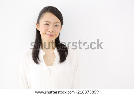 Young woman thinking isolated on white background