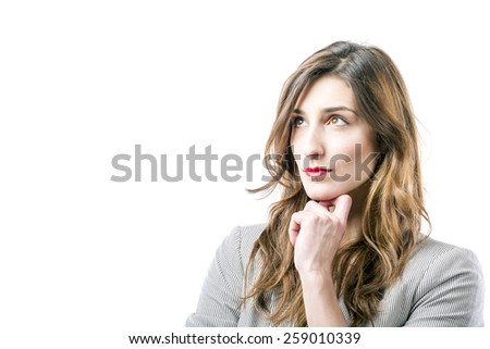 Young woman thinking on white background - stock photo