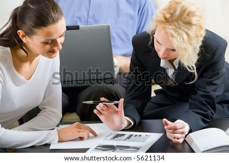 Young woman thinks of a question asked by her potential employer - stock photo