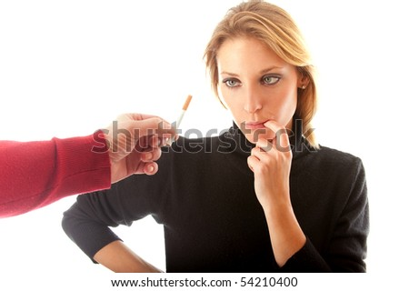 Young woman thinks - to take or not cigarette? - stock photo