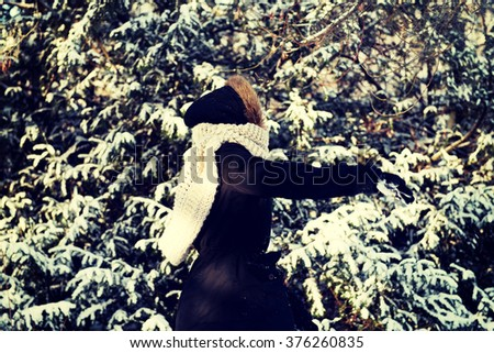 Young woman throwing snowball - stock photo