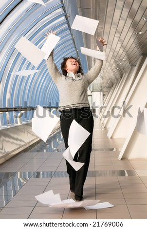 Young woman throwing up documents