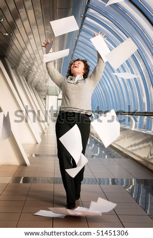 Young woman throwing up documents - stock photo