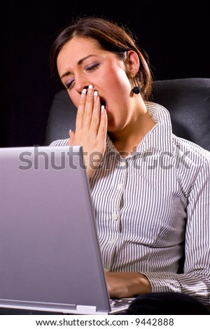 Young woman tired from work and wants to sleep - stock photo