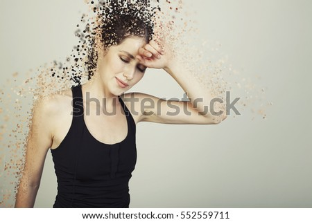 young woman  tired on bg disintegrate into particles effects