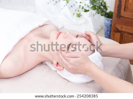 Young woman to head massage