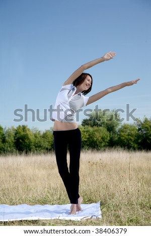 young woman to practice gymnastics in natural surroundings