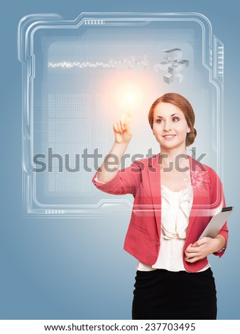 young woman touching a virtual interface - stock photo
