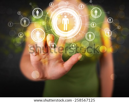 Young woman touching future technology social network button