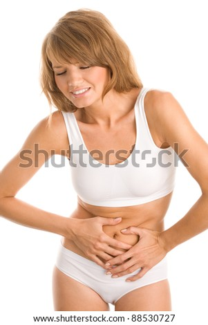 Young woman touching her belly - stock photo