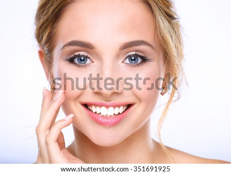 Young woman touching her face isolated on white background - stock photo