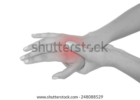 Young woman touching her injured hand on white background