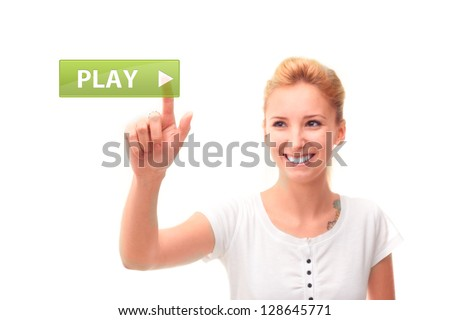 Young woman touching play on the screen - stock photo
