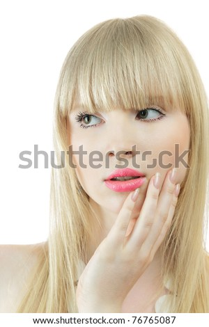 Young woman touching skin on cheek looking sidewards - stock photo