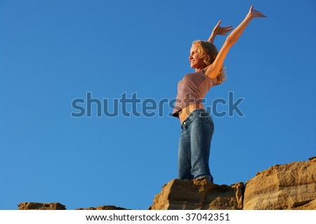 young woman tourist at the top of mountain - stock photo
