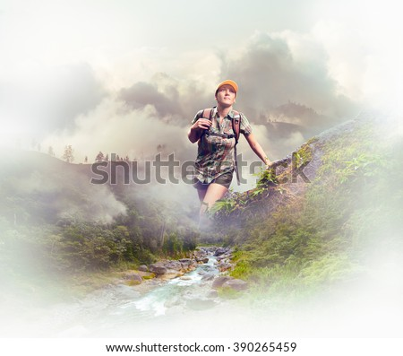 Young woman tourist with a backpack walking in the rain forest on background mountains.  Concept eco tourism, hiking in the mountains. - stock photo