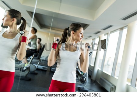 Young woman training in the gym - stock photo