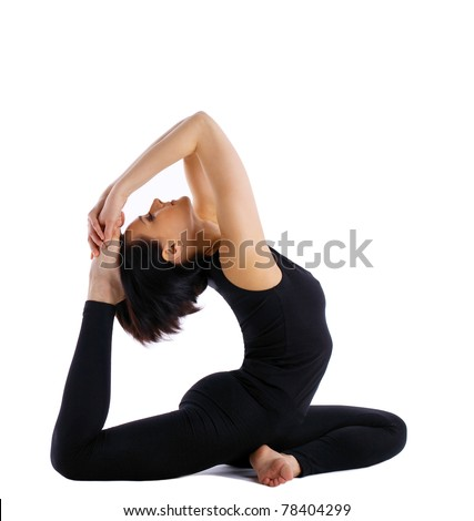 young woman training in yoga asana - pigeon pose isolated - stock photo
