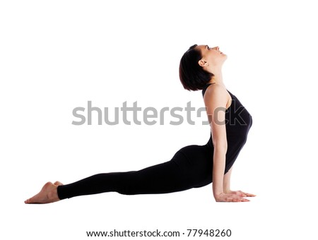 Young woman training yoga - upward facing dog - stock photo