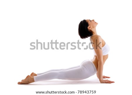 Young woman training yoga - upward facing dog - stock photo