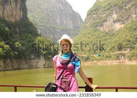 Young woman traveler at the tourist cruise boat at Three Gorges on Yangtze river, China - stock photo