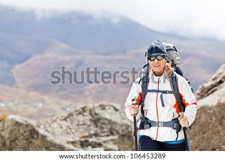 Young woman trekking in Himalaya Mountains in Nepal - stock photo