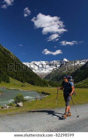 Young woman trekking in the Austrian Alps - stock photo