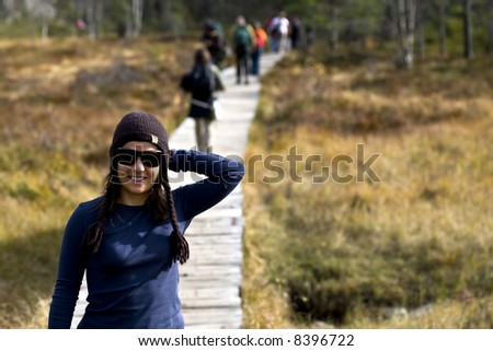 Young woman trekking in the mountains - stock photo