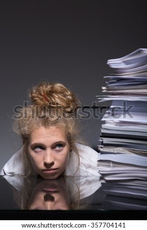 Young woman trying to overcome burnout at work - stock photo