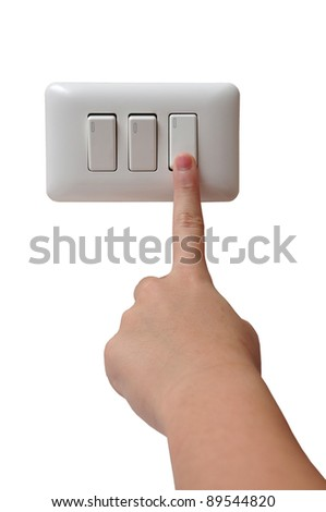 Young Woman Turning Off Light Switch
