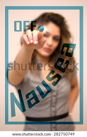 young woman turning off Nausea on screen - stock photo