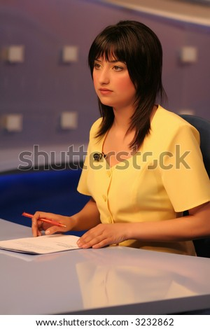 Young woman TV reporter presenting the news - stock photo