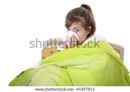 young woman under a bedspread , blowing her nose. isolated on white - stock photo