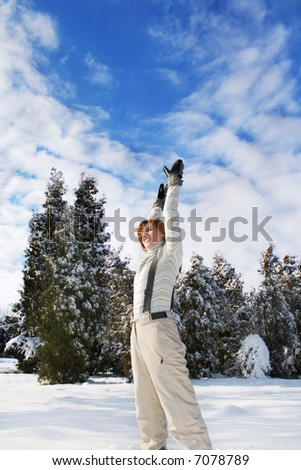 young woman under blue sky - stock photo