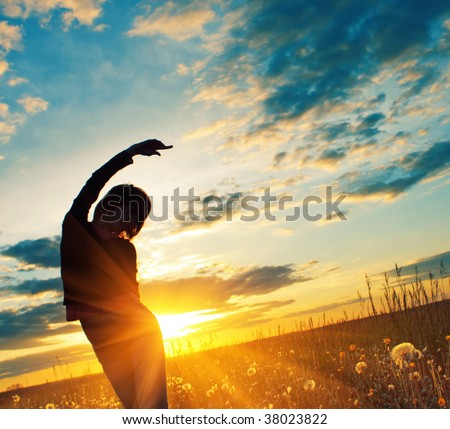 Young woman under sunset light - stock photo