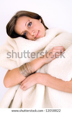 Young woman under woolen blanket - stock photo
